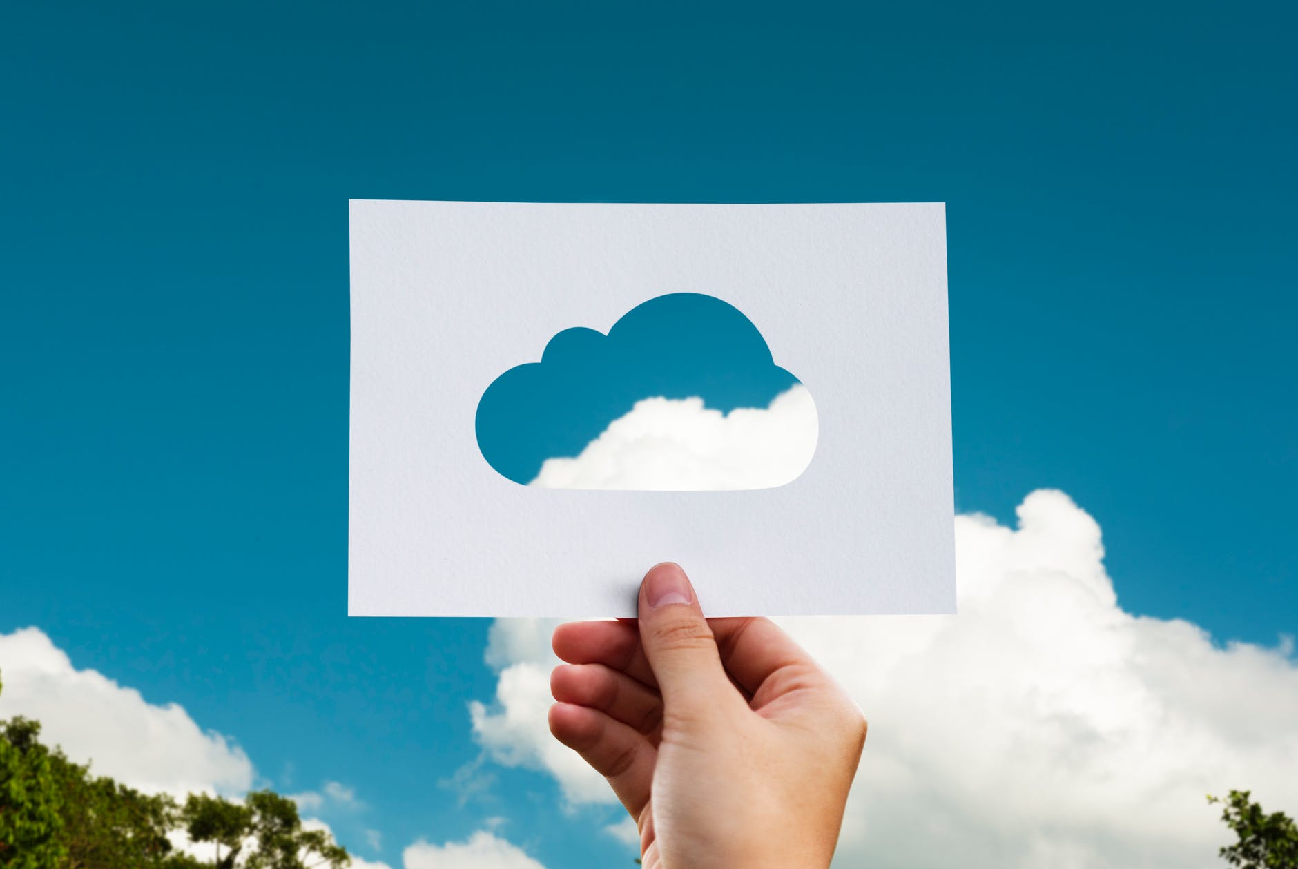 blue skies clouds cut fingers - Leveraging Cloud Technologies in the Oil and Gas Industry