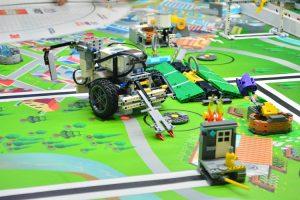 remote control toy car on green car track 300x200 - remote control toy car on green car track