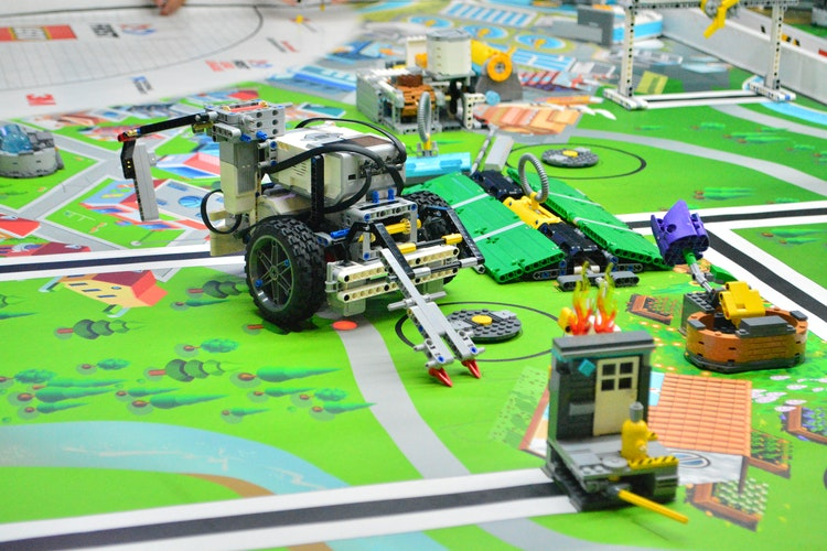 remote control toy car on green car track - 8 Undeniable Benefits of Robots in the Oil and Gas Industry